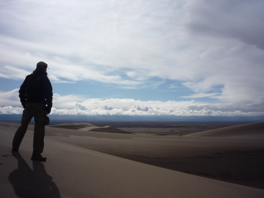 overlooking sand dunes and plains