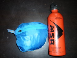 Jacket packed in own pocket with 22oz MSR fuel bottle for comparison
