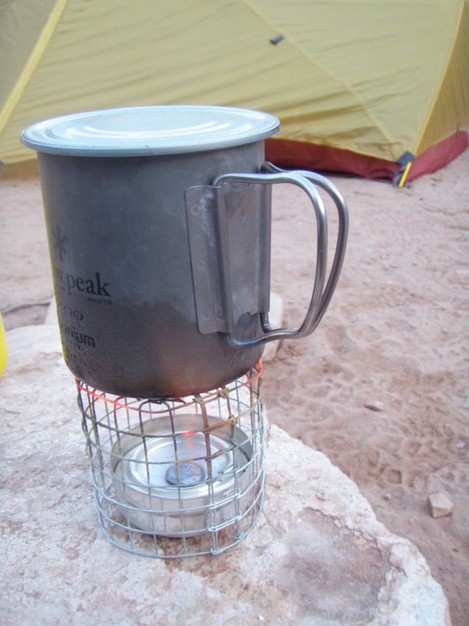 Cooking with homemade alcohol penny stove.