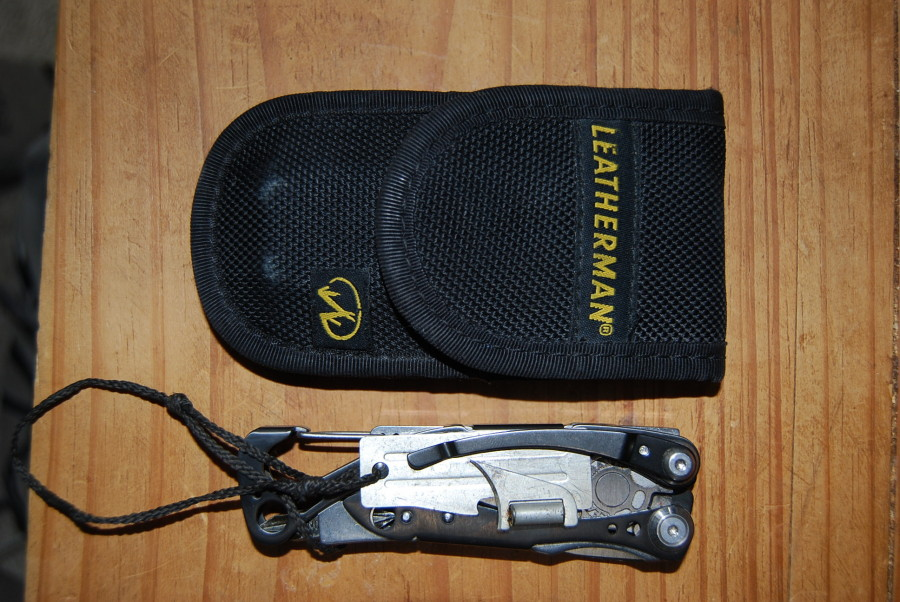Skeletool with can opener and sheath
