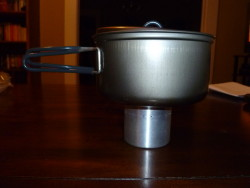 Evernew 0.9L Non Stick Ti Pot on a White Box Stove
