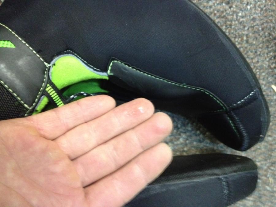 Wet fingertips from inside shell
