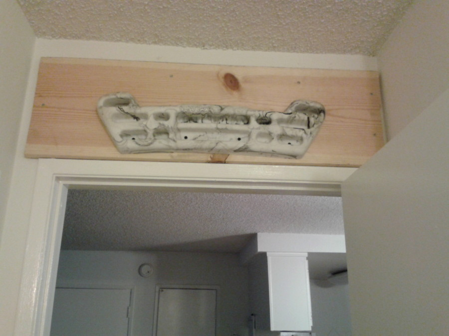 Mounted above a doorway.