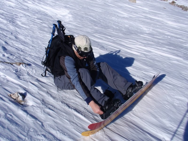 splitboard, carrying the poles.